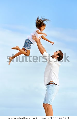 Man holding child on beach Stock photo © IS2