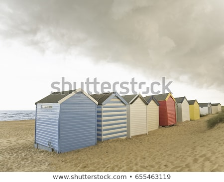 Beach huts under brooding sky Stock photo © IS2