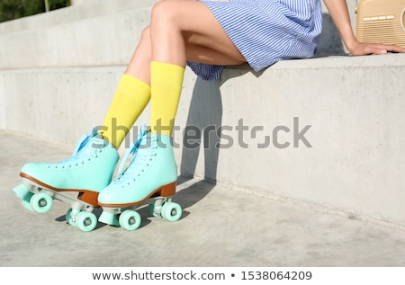 Roller derby girl sitting on stairs Stock photo © sumners