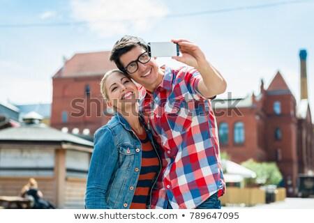 Tourist couple taking selfie on rooftop in Berlin Stock photo © Kzenon