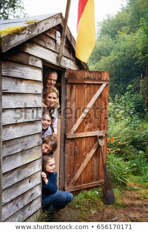 Grandparents and children hiding in shed Stock photo © IS2