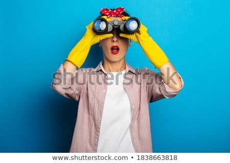 Woman looking through binoculars smiling Stock photo © IS2