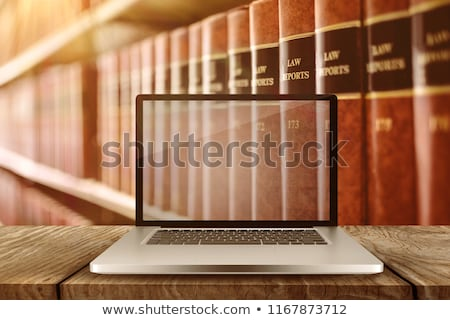 laptop with with screen against close up of old books stock photo © wavebreak_media