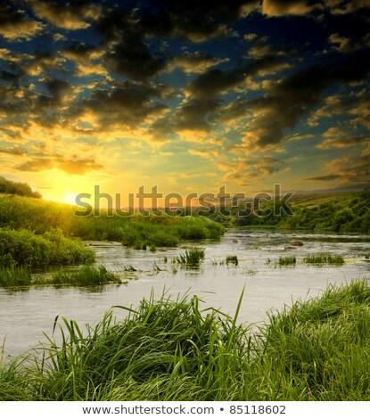 Lake with dramatic lighting Stock photo © stokkete