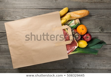 Stock photo:  Grocering concept. Full paper bag of different fruits