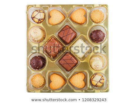 Luxury belgian chocolate and biscuit cookies selection in original golden tray and white background. Stock photo © DenisMArt