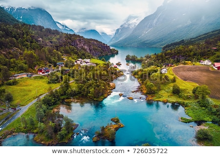 Légifelvétel tó Norvégia hegyek mögött folyó Stock fotó © Mps197