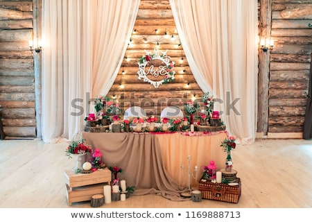 Stock photo: Rustic wedding decor on a timber background. Main table setting for bride and groom newlyweds