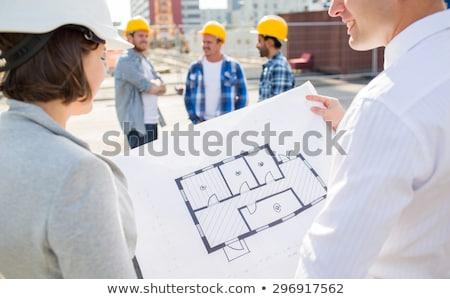 Mulher trabalhando engenheiro edifício planos Foto stock © diego_cervo