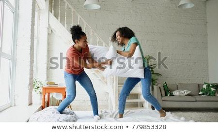 Mutlu kadın arkadaşlar yastık kavgası ev dostluk Stok fotoğraf © dolgachov