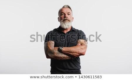 Ciddi adam dövme kol beyaz gömlek Stok fotoğraf © ruslanshramko