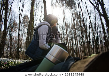 A Hiker Taking a Rest on Log Stock photo © colematt