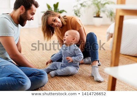 happy family with baby boy playing at home stock photo © dolgachov