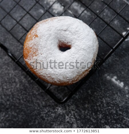 Homemade Donuts With Powdered Sugar On A Cooling Tray Stock photo © mpessaris