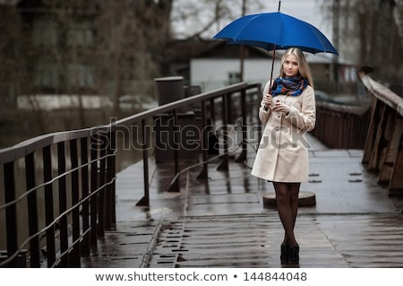 Raining scene with girl on the bridge Stock photo © colematt