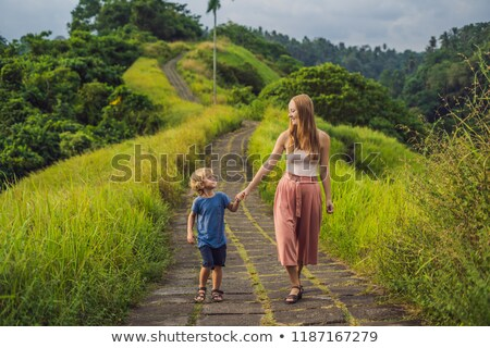 Mom and son tourists in Campuhan Ridge Walk , Scenic Green Valley in Ubud Bali. Traveling with child stock photo © galitskaya