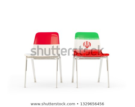 two chairs with flags of indonesia and iran stock photo © mikhailmishchenko