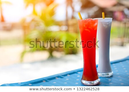 tequila sunrise and pina colada cocktails under the palm stock photo © dashapetrenko