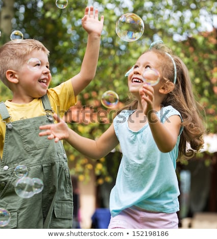 Boy and Girl Gardening at Yard Stock photo © colematt