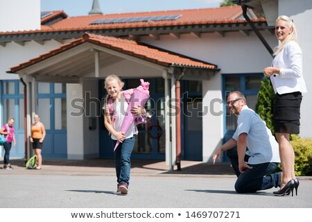 Little girl getting out of school after her first day Stock photo © Kzenon