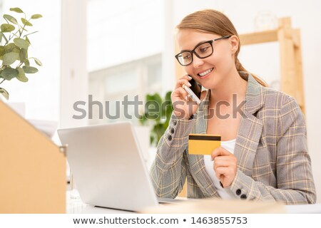 pretty well dressed businesswoman talking to online shop manager on mobile phone stock photo © pressmaster