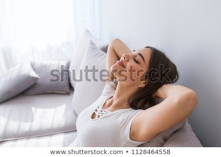 portrait of a happy woman lying on sofa stock photo © andreypopov