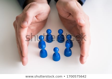 Businessperson Protecting Pawn Figures Stock photo © AndreyPopov