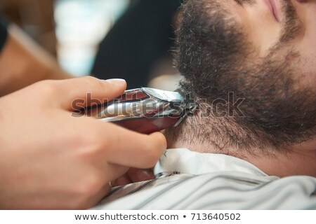 Professional barber trimming the client's hair Stock photo © Kzenon