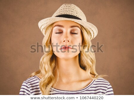 Close up of millennial woman eyes closed against brown grunge background Stock photo © wavebreak_media