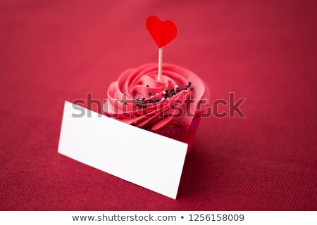cupcake with heart cocktail stick and nametag Stock photo © dolgachov
