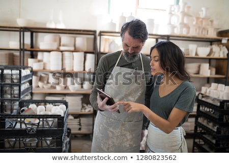Potter colleagues talking over the tablet  in the pottery workshop Stock photo © wavebreak_media