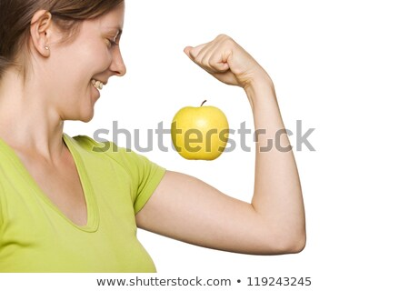 Green apple floating above woman's arm. stock photo © lichtmeister