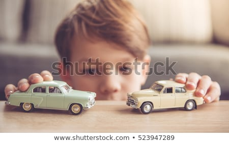 Man playing with toy car Stock photo © ilona75