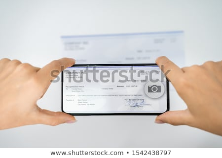 Woman Taking Photo Of Cheque To Make Remote Deposit Stock photo © AndreyPopov