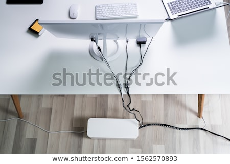 Compute And Laptop With Cable Organizer Box At Office Stock photo © AndreyPopov