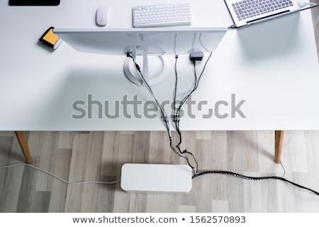 Laptop cavo organizzatore finestra ufficio view Foto d'archivio © AndreyPopov