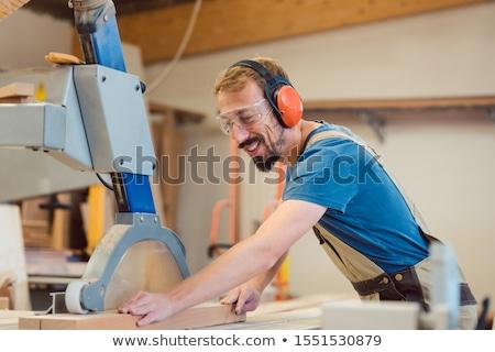 Pracowity stolarz zabawy pracy kawałek drewna Zdjęcia stock © Kzenon