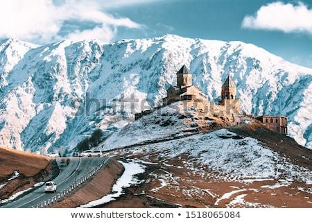 Kerk Georgië bergen landschap sneeuw Blauw Stockfoto © borisb17