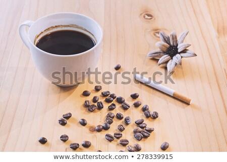 Papierosów filiżankę kawy fasola złe Zdjęcia stock © dolgachov