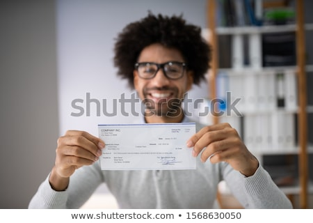 Affaires chèque souriant Photo stock © AndreyPopov