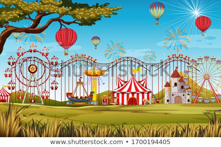 Themepark scene with many rides in the big field Stock photo © bluering
