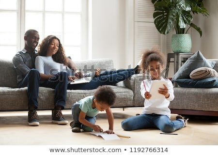 happy family spending free time at home Stock photo © dolgachov