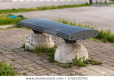 Vacant bench in an urban park in close up Stock photo © Giulio_Fornasar