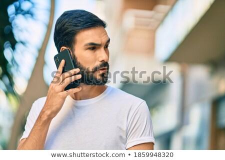 homem · falante · telefone · móvel · avião · sorrir · paisagem - foto stock © pressmaster