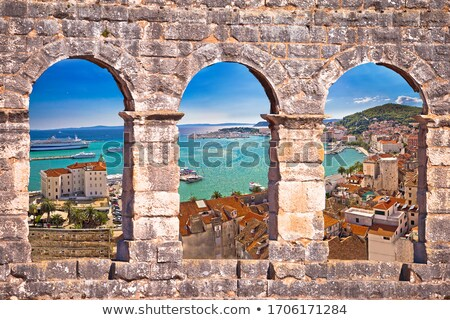 Split waterfront aerial panoramic view through stone window Stock photo © xbrchx