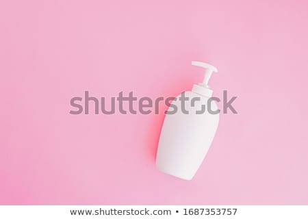 Bottle of antibacterial liquid soap and hand sanitizer on pink background, hygiene product and healt Stock photo © Anneleven