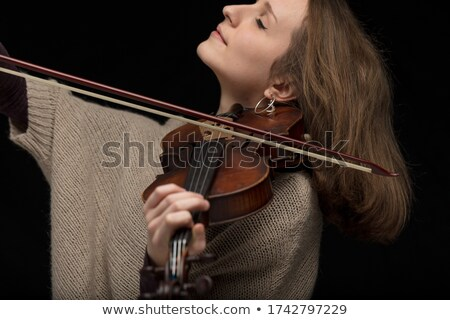 Passionate female violinist playing baroque guitar Stock photo © Giulio_Fornasar