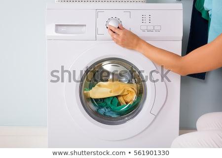 Kişi el çamaşır makinesi elbise çamaşırhane kadın Stok fotoğraf © AndreyPopov