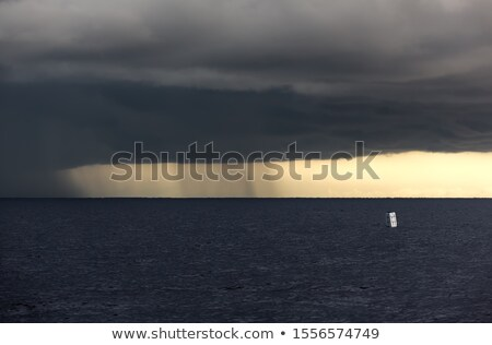 Sailing in stormy weather in tropical climate Stock photo © mtilghma