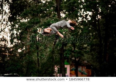 salto · em · altura · árvores · sucesso · beautiful · girl · alto · voador - foto stock © darrinhenry